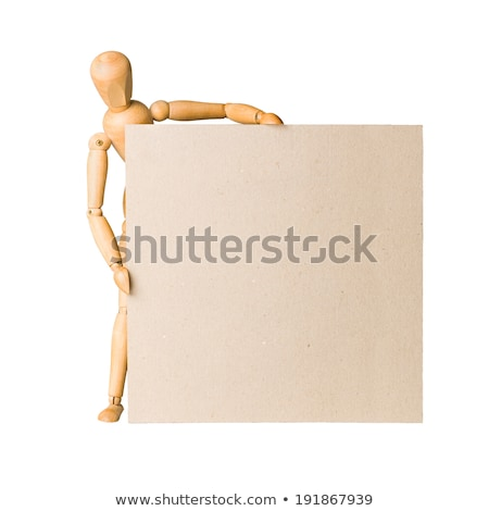 wooden model dummy holding blank carton board stock photo © pakete