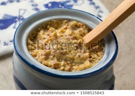 Durva mustár tál gabona fehér háttér Stock fotó © Digifoodstock