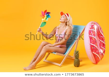 young pretty woman at swimming pool relaxing in chair fashion vacations concept people stock photo © iordani