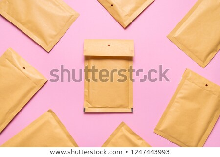 yellow shipping envelope isolated stock photo © pcanzo