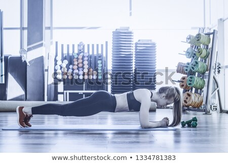 Side view of girl engaged yoga Stock photo © deandrobot
