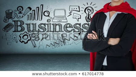 Business woman superhero mid section with arms folded against blue wall with business doodles stock fotó © wavebreak_media