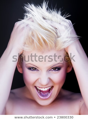 young blond woman crazily screaming stock photo © konradbak