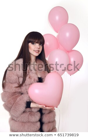 young smiling woman in fashion fur coat holding pink heart over stock photo © victoria_andreas