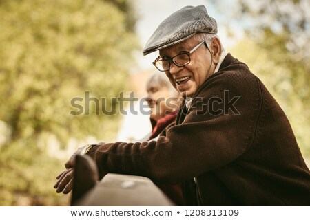 Smiling senior man leaning on wooden fence Stock photo © wavebreak_media