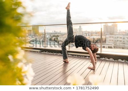 Businessman practice yoga Stock photo © alphaspirit