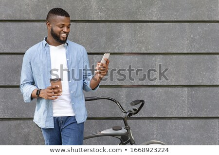 Stock photo: Men next to bicycle, coffee break