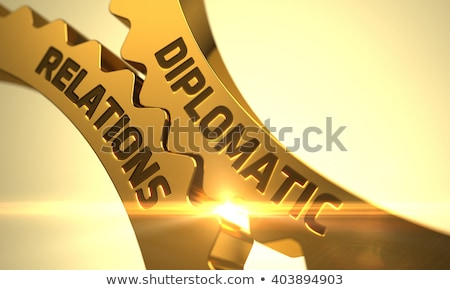 Diplomatic Relations Concept. Golden Cogwheels. Stock photo © tashatuvango