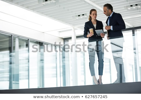 business colleagues talk in a lobby stock photo © is2
