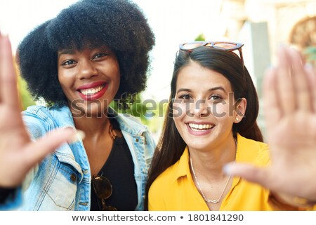 Pretty Young Woman Smiling in the Park with Picture Frame Stock photo © feverpitch