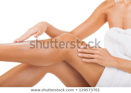 Beautiful smooth and shaved woman's legs. Isolated on white  Stock photo © Nobilior