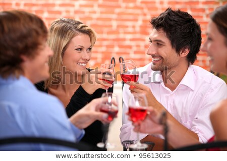Friends toasting with white wine joyous event Stock photo © boggy