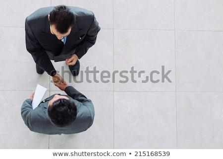 View uomini d'affari parlando business lavoro manager Foto d'archivio © IS2