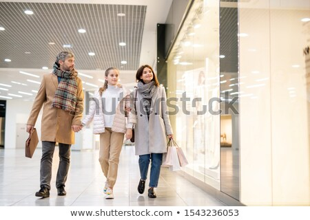 a middle eastern man with two children in a shopping mall stock photo © monkey_business
