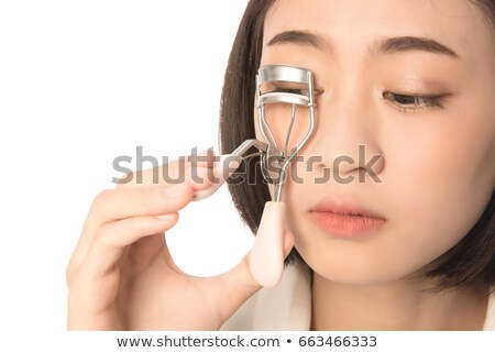 Woman using an eyelash curler Stock photo © IS2
