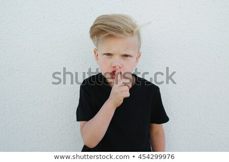 Boy with finger on lips Stock photo © IS2