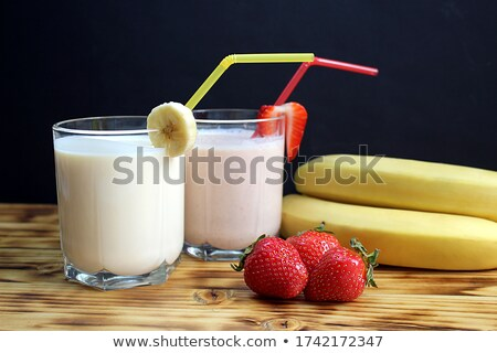 couple of glasses of strawberry milshake stock photo © mpessaris