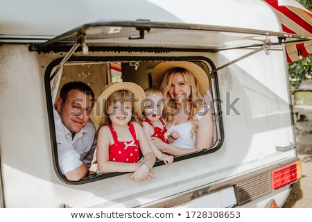 Two women sitting at campsite laughing Stock photo © IS2