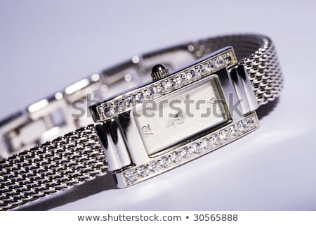Female silver wrist watch with diamonds Stock photo © gsermek
