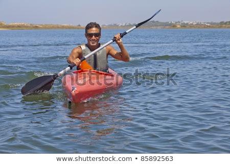 Jóképű férfi kajakozás tó tenger csónak kép Stock fotó © deandrobot