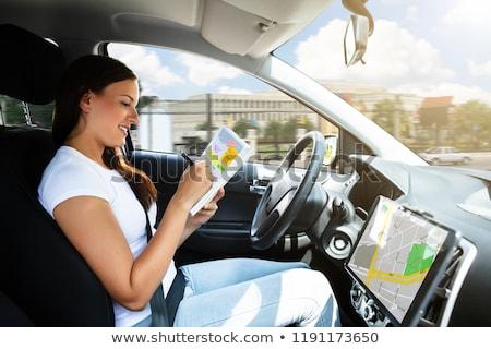 Kobieta posiedzenia wewnątrz samochodu piśmie harmonogram Zdjęcia stock © AndreyPopov