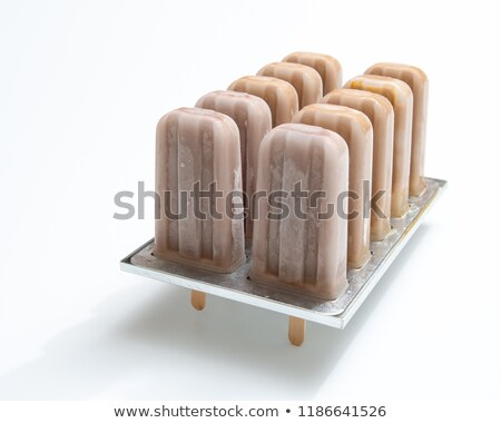 healthy chocolate ice cream on a stick in a form on a white background with copy space a delicious stock photo © artjazz