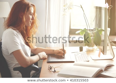 redhead woman with tablet pc working at office Stock photo © dolgachov