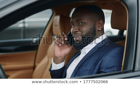 cose up portrait of a happy young afro american man stock photo © deandrobot