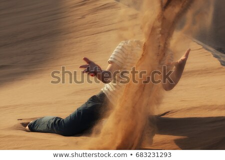 Stock photo: Kid Throwing Sand