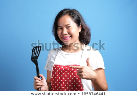 Asian beautiful attractive woman posing isolated indoors showing okay gesture. Stock photo © deandrobot
