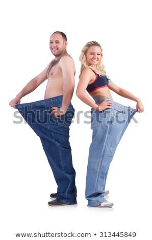 Dois caber mulher jovem solto jeans perder peso Foto stock © ruslanshramko