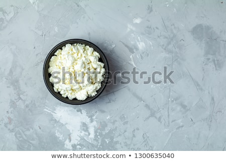 Stock photo: Homemade cottage cheese in a black ceramic bowl