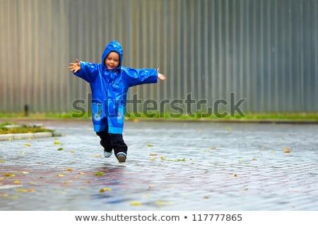 Pequeno menino azul capa de chuva ilustração criança Foto stock © colematt