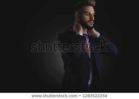 businessman holding back of neck looks down to side stock photo © feedough