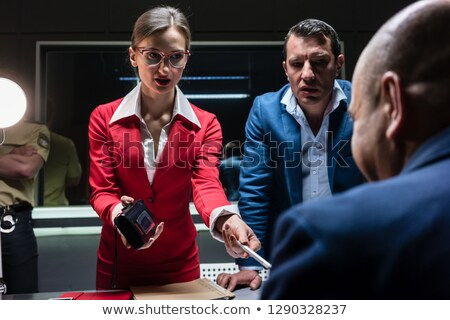 Two persuasive investigators trying to obtain a confession Stock photo © Kzenon