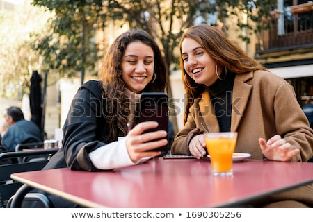 Portrait of young woman 20s wearing casual clothes laughing whil Stock photo © deandrobot