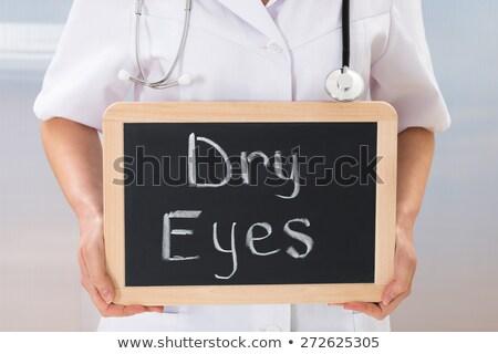 Feminino médico secar olhos texto Foto stock © AndreyPopov