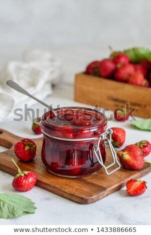 fresh raw organic berries in white wooden box on white kitchen table background close up strawberr stock photo © denismart