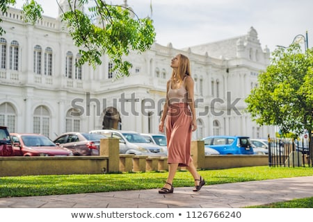 Young woman on the background of City Hall in George Town - Penang, Malaysia. British built historic Stock photo © galitskaya