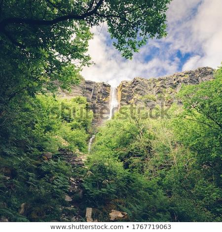 água penhasco cara azul montanhas Foto stock © lovleah