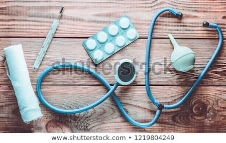 view of stethoscope drug and equipment on foreground table with stock photo © freedomz