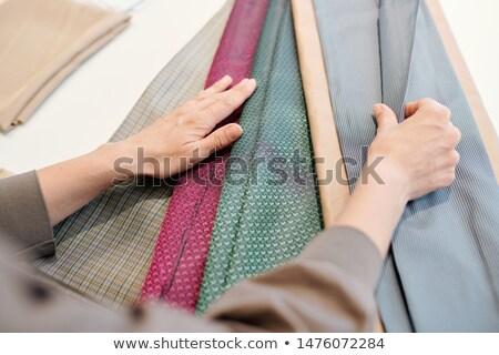 Femenino disenador mirando textiles nuevos colección Foto stock © pressmaster