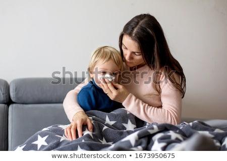 мальчика грипп сморкании домой кровать Сток-фото © Lopolo