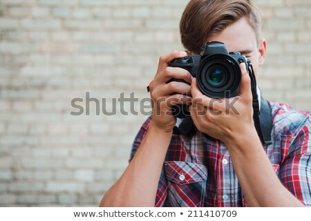 young man photograph with his digital camera  Stock photo © Lopolo