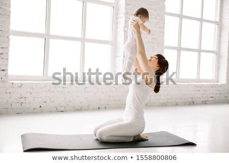 Anne bebek jimnastik yoga yalıtılmış beyaz Stok fotoğraf © Lopolo
