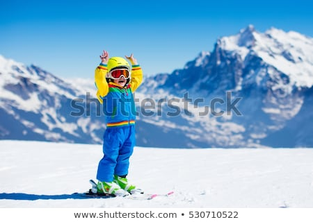 Family with children on a ski slope. Stock photo © ConceptCafe