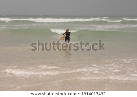 Fronte view senior femminile surfer tavola da surf Foto d'archivio © wavebreak_media