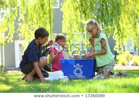 Fiatal lány újrahasznosít tároló kívül lány mosoly Stock fotó © Lopolo