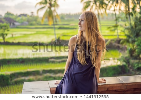Women tourists enjoy the panoramic view of the beautiful Asian scenery of rice fields Stock photo © galitskaya