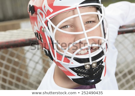 young teen hockey goaler outside in the arena Stock photo © Lopolo